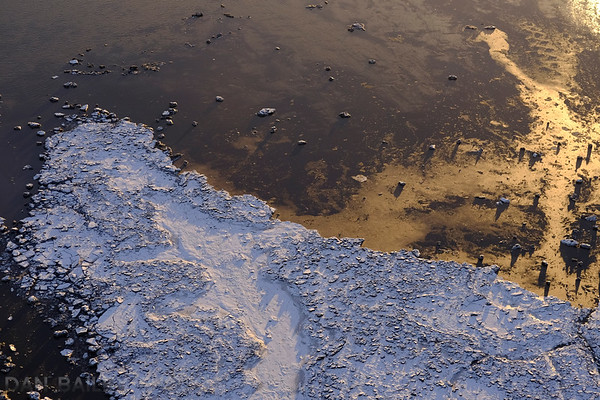 Aerial photo of the frozen mud flats at the edge of the Cook Inlet, Alaska