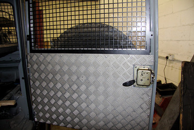 Grille and metal sheet fitted to rear door.