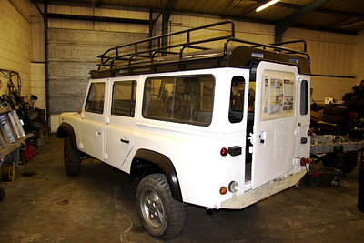 The rear door and front passenger doors will both be replaced. The roof rack will be removed.