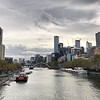 """Alright, now that the """"Welcome"""" festivities were done it was time to start checking out what we came for... starting with Melbourne, Australia! :-)<br /> <br /> There's a peek at the """"Yarra River"""" which cuts right through Melbourne... FYI, the beige building on the left is the """"Langham Melbourne"""" where Tauck had us stay... perfect location in the Heart of the City!"""