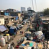 """**NOTE** When we did our Tauck tour they DIDN'T include a visit inside the heart of a """"Slum"""" area.<br /> <br /> Due to high interest though, starting in 2019, Tauck WILL be taking guests into the """"Dharavi District"""". (Some scenes from """"Slumdog Millionaire"""" were filmed here & this is the most well known """"Slum"""" in India)<br /> <br /> Due to that, we spent an extra day on our own in Mumbai to visit this area to give our clients a taste of what to expect.<br /> <br /> AND, just like earlier when we showed you the """"Dhobi Ghat"""" laundromat this is NOT what you'd expect!!!!!<br /> <br /> These are NOT poor people the way we think of them... they simply live here due to ridiculous housing prices in the area. <br /> <br /> These are WORKING class people, there are TONS of businesses/manufacturing in this district producing over $1 Billion USD of goods per year!!<br /> <br /> These people are clean (for example, we saw LOTS of Barbershops throughout), proud & there's literally NO Crime here... they help each other, ALL the religions mix together in here, they don't take from each other as our competitive World does, etc.... maybe we could all learn to simplify in our Western World & live a little happier with each other??<br /> <br /> Anyways, it was SUPER interesting & eye-opening visiting this """"Slum"""" (they definitely need to come up with a better name as """"Slum"""" doesn't do it justice!) and we know you'll enjoy your visit here when doing a Tauck Tour in 2019 & beyond!"""