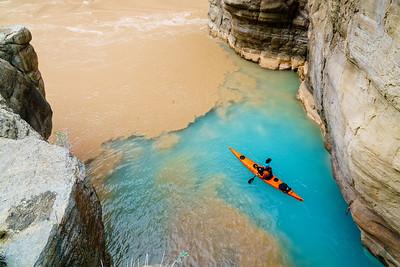 Seth Swallen paddles into the murky depths of the Colorado River from Havasu Creek.