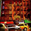 Old Buildings of New York City with Cars and Taxi