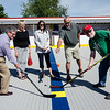 Mayor Stephen DiNatale, Denise Loumis, Darlene Westlund, the daughter of Carmelita Landry, league president Tom MacMaster and Mike Baltier during the dedication of the new Fitchburg Street Hockey League rink on Saturday afternoon. SENTINEL & ENTERPRISE / Ashley Green