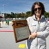 Darlene Westlund shows off the original plaque dedicating the Carmelita Landry Arena in her mother's name. The Fitchburg Street Hockey League dedicated the new rink to Landry on Saturday afternoon. SENTINEL & ENTERPRISE / Ashley Green