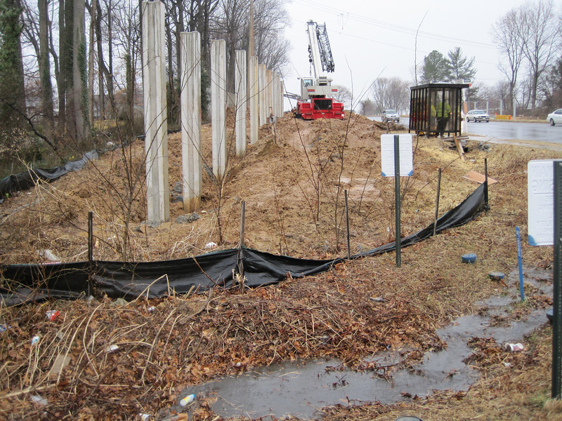 Unconsolidated slopes left exposed in rain.  Fallen silt fence is probably a remnant of earlier work.  Southeast quadrant of I-495/Braddock Rd interchange. 28 Feb 2011