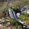 Abandoned silt fence<br /> Eroding conveyance channel<br /> 38.835849, -77.219781