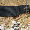 another spot where water flowed under fence