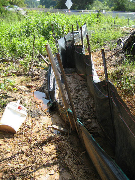 The upstream SW controls are clearly not adequate.  Double silt fences is strictly prohibited