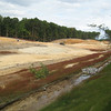 Parallel drainage channels, one treated, one untreated. Fairfax County Parkway extension construction 091009