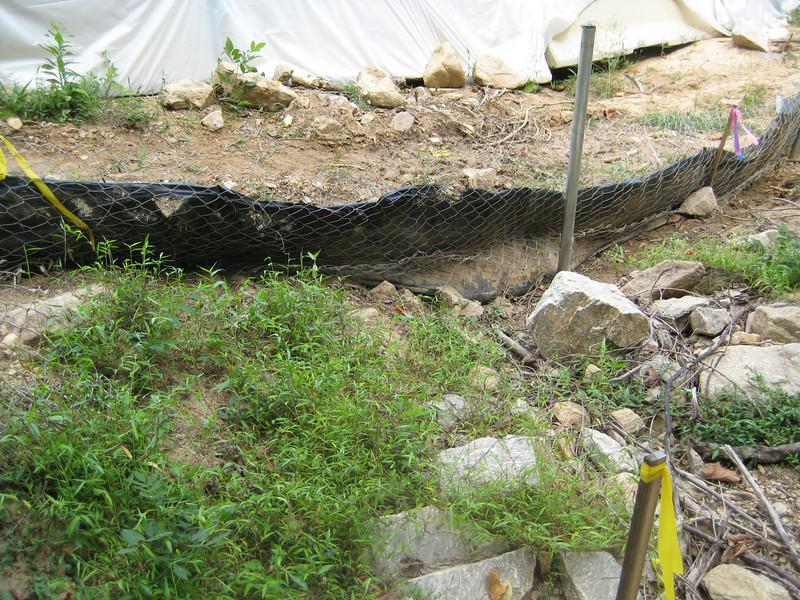 Failed super silt fence near bridge site. Fairfax County Parkway extension construction 091009