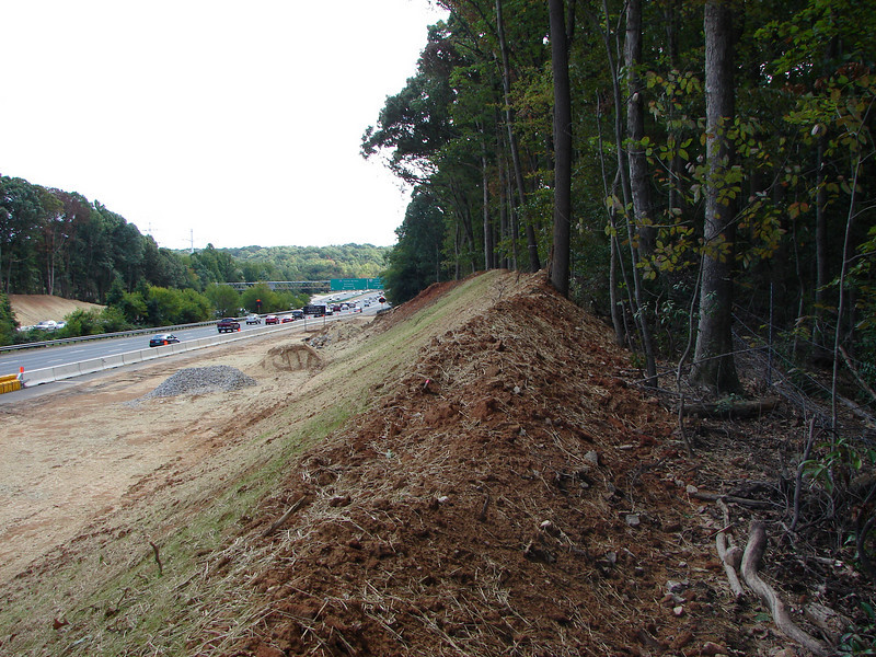 Overview of the construction site. Note how the absence of seeded grass on the forest-facing side of the slope.  No perimeter sediment control