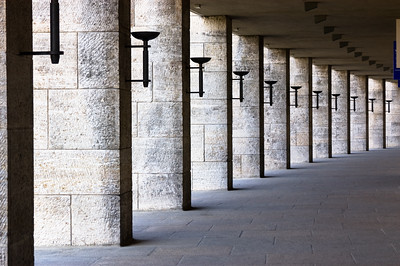 Torches align the outside columns from Olympic Stadium, Berlin, Germany