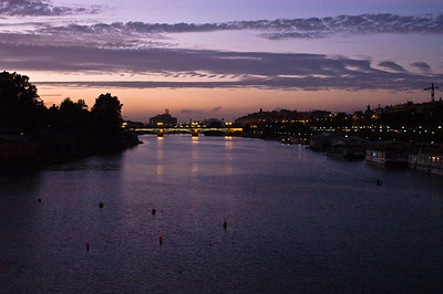The Puente de Isabel II Bridge spanning the Guadalquivir River at dusk Sevilla, Andalucia, Spain.