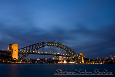 Sydney Harbor bridge at dusk.