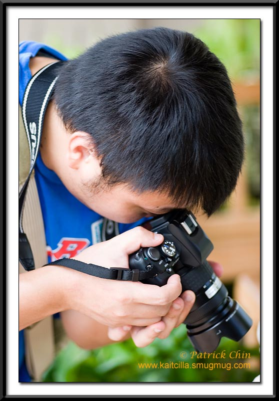 My buddy Eddie concentrating on a macro shot. This was shot with the Tokina 100mm macro lens.