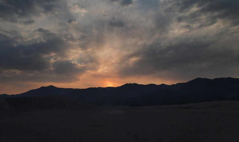 This was sunrise, 29 June 2011. While it might look pretty, all of those clouds were a bad sign. In fact, the morning stayed cloudy until about 9:00 a.m.. I started climbing before 6:00 a.m., but by the time sunrise was supposed to take place, the light was rather dull, filtered through the clouds. Whenever a photo was shot looking westward, however, you will see clear blue skies in the photos. It was very frustrating. Some of the images still manifest some contrast, but not the kind one hopes for at this early morning hour.