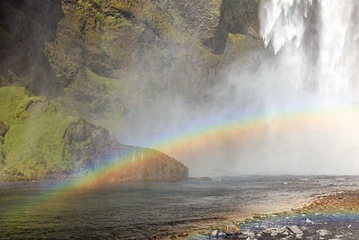Rainbow At Skógafoss Waterfall In Iceland