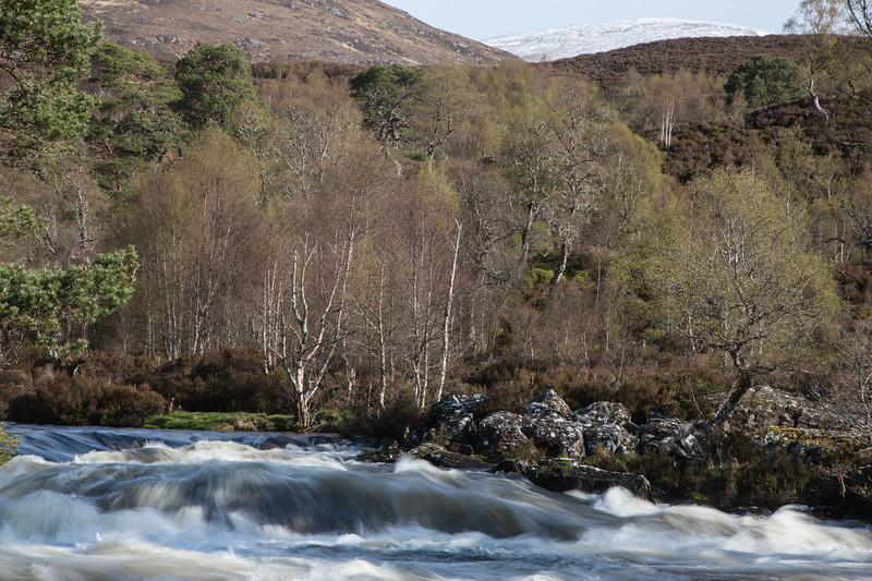A fast flowing Affric river swolen with melt water from the snow melting highlands