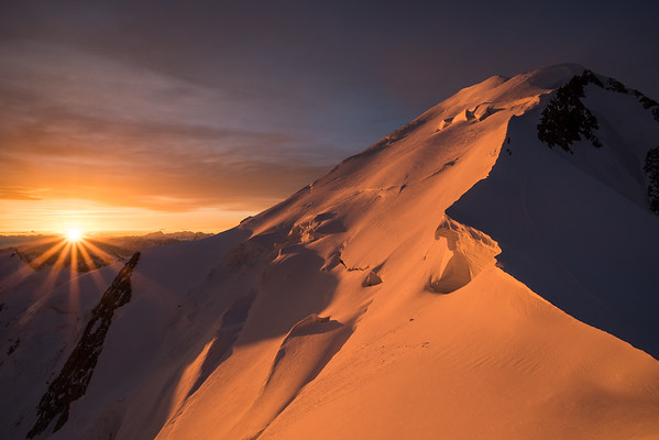 Mont Blanc and alpinists at sunrise from the Arete des Bosses, France