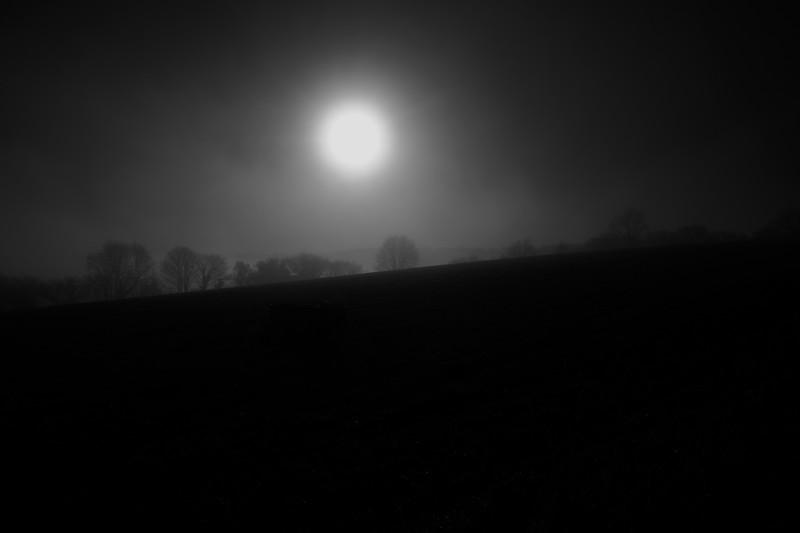 Sun Over Misty Silhouette Landscape