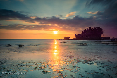 Tanah Lot temple and beach at sunset in Bali