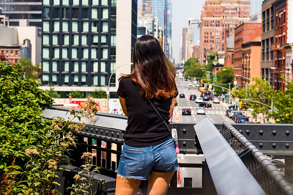 Young Woman on the Highline Overlooking Manhattan