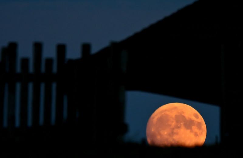 Full moon seen through old building window
