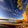 Boat dock and autumn trees along a Saskatchewan Lake