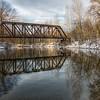 Bridge Reflection on a Snowy Day