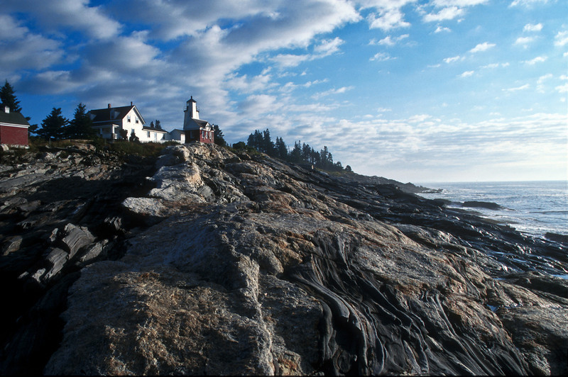 LH005<br /> Pemaquid Point<br /> This Maine Lighthouse sits atop one magnificent rock formation at the tip of Pemaquid Point.  This shot was taken at sunrise from near the edge of the ocean.