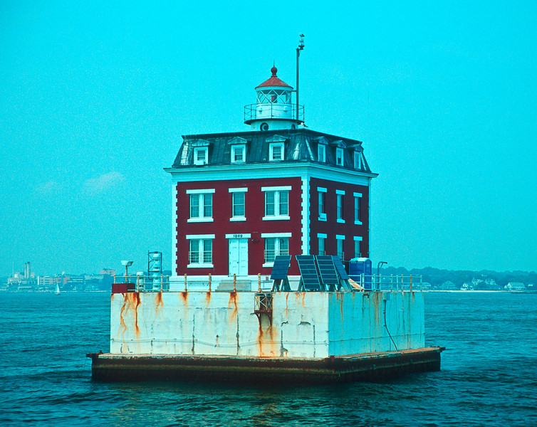 LH011<br /> New London Ledge Light<br /> Architecturally speaking this light house is definitely out of character for New England.  This light in New London, Connecticut is reputed to be haunted.
