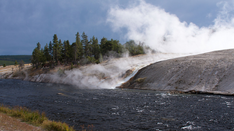 A stream of very hot water flows from the Grand Prismatic Spring into the Firehole River.   YNP