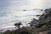 Noordhoek, The Hoek, Surfer surfing break, turquoise sea, granite and misty greys