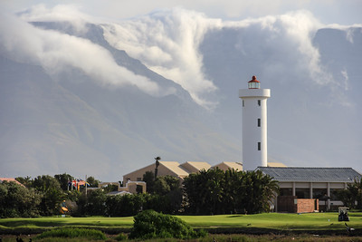 Milnerton Lighthouse, with Table Mountain draped in clouds