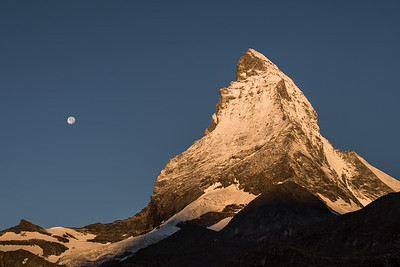 Matterhorn and moon at sunrise, Switzerland