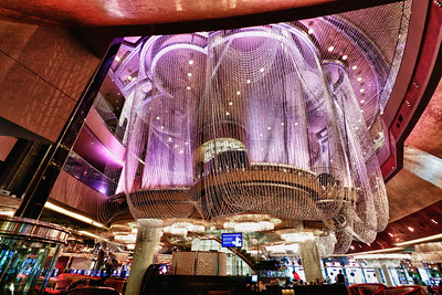 The chandelier bar at the Cosmopolitan hotel. The creation is a living, breathing architectural wonder created by luminous beaded curtains of light.