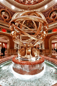 The gold globe fountain is the center point of the grand lobby at the Venetian. Guests are encouraged to make a wish as they toss coins into the fountain for good luck.