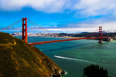 The Golden Gate Bridge is one of the world's most beautiful bridges and an engineering marvel. With its tremendous towers, sweeping main cables, signature International Orange color, and Art Deco styling, it is a sensory experience featuring color, light, and sound.