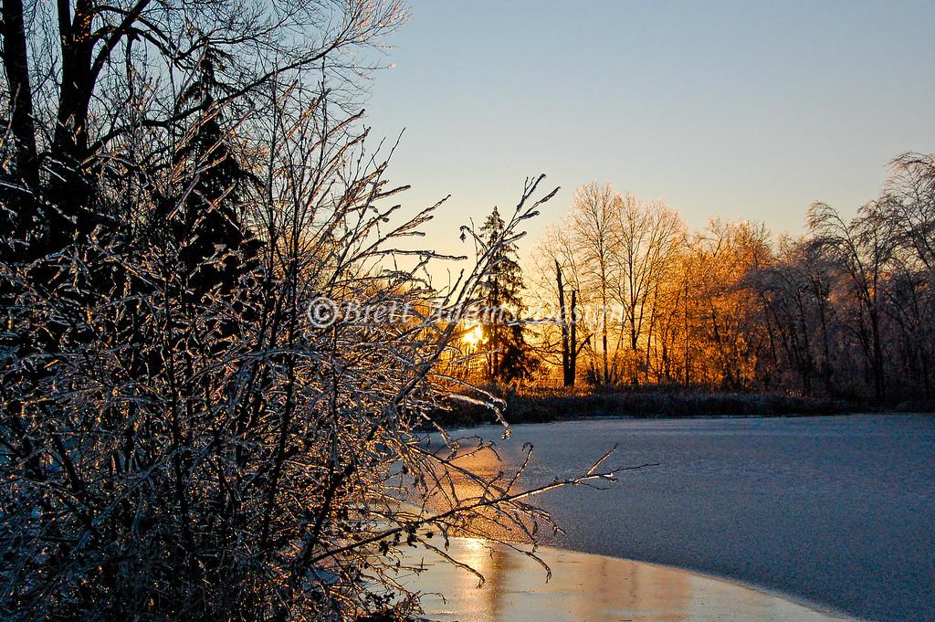 Frozen Pond Sunrise. Colonie, NY