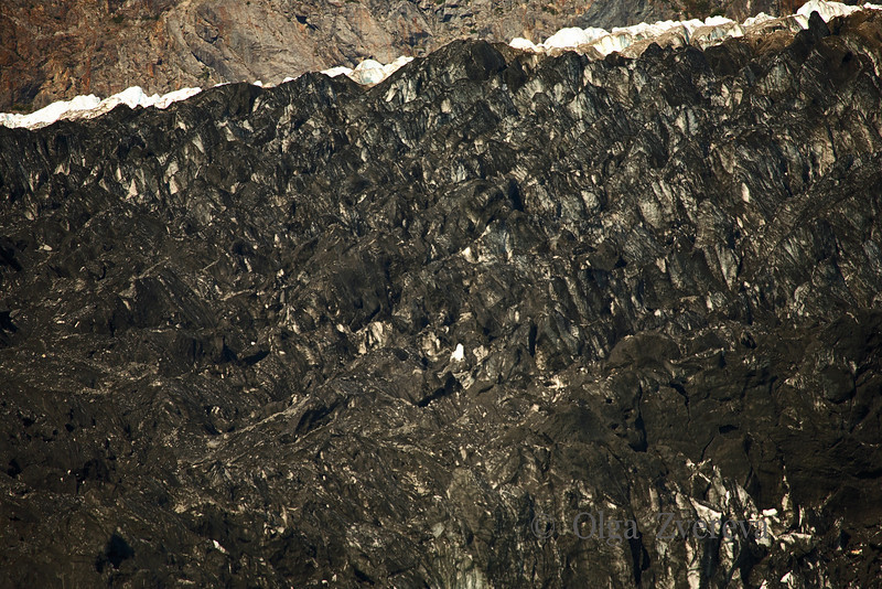 <p>Black ice of glacier. Glacier Bay National Park, Alaska, USA. </p>