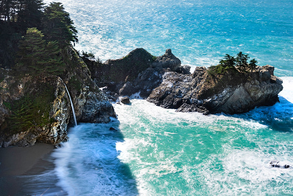 The impossible beauty of Big Sur's McWay Falls.  An unlikely tropical scene amidst the jagged coastline of Northern and Central California, this 80' high year-round waterfall emerges from the cliffside in Julia Pfeiffer Burns State Park, and falls to the beach below.  Its one of only two waterfalls on the California Coastline that falls directly into the ocean below.