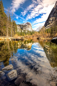 Yosemite Valley's Mirror lake doing exactly as it's name suggests.  Spring runoff causes this wetland area to expand into a temporary lake which on calm days, beautifully reflects the amazing scenery around it.