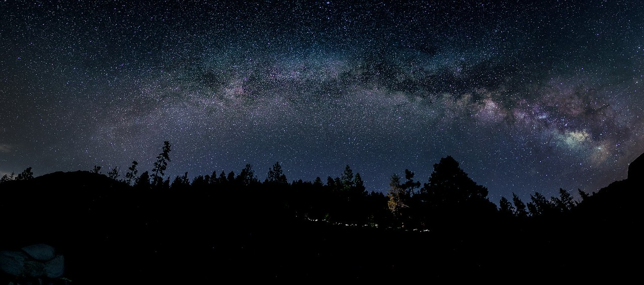 The galactic core of the Milky Way quietly rises over the trees near Lake Tahoe, CA.