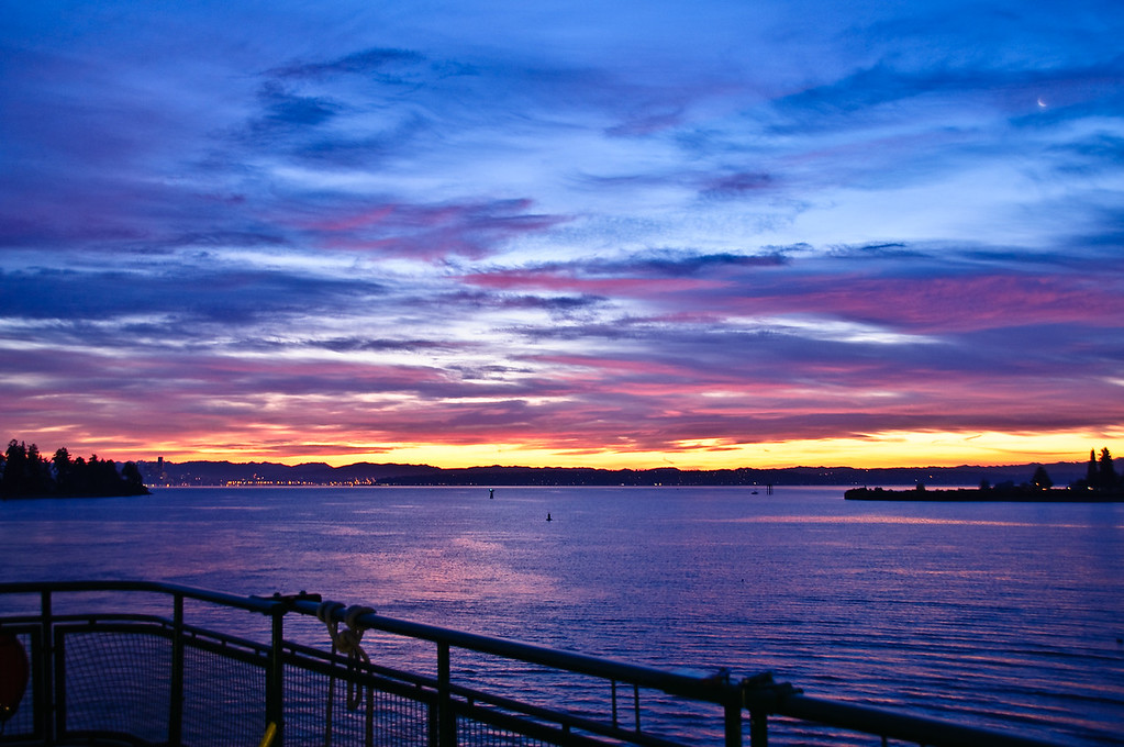 Sunrise over Seattle and Eagle Harbor from ferry.