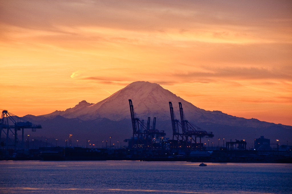 Sunrise over Mt Rainer and Port of Seattle.