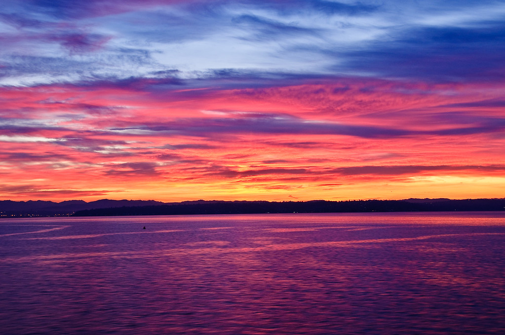 Sunrise over Seattle and the Puget Sound from ferry.