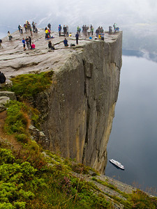 Preikestolen / Prekestolen, in English known as Preacher's Pulpit or Pulpit Rock. The cliff hangs 600 meters above Lysefjorden, East of Stavanger. Even though a two hours hike is required to get there, it is one of the most visited tourist attractions in Norway.