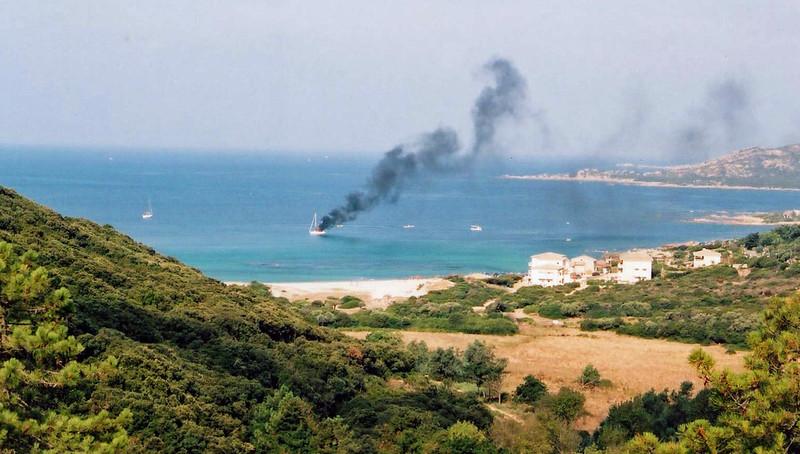 a boat on fire in Tizzano Bay, Corsica - 2005
