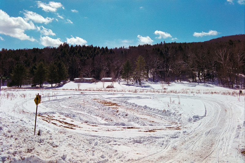 On the way to Woodstock.  Snowmobile training field.  Just behind the brown covered bridge. (Film)
